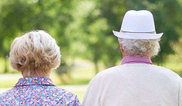 retirement planning tips couple walking park